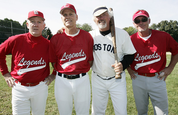 Members of the North Shore Oldtimers from left, John Tudor, Rawly Eastwick, Bill Lee and Chris Howard, pose together before the start of the game against the Peabody Police Department to benefit Jimmy Fund. Photo by Deborah Parker/September 7, 2009