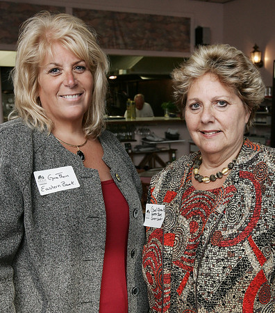 Gina Flynn of Eastern Bank and Carol Gorevitz of the North Shore Career Center of Salem attend Chamber After Hours, a Salem Chamber of Commerce networking event held at Caffe Graziani Thursday evening. Photo by Deborah Parker/August 20, 2009