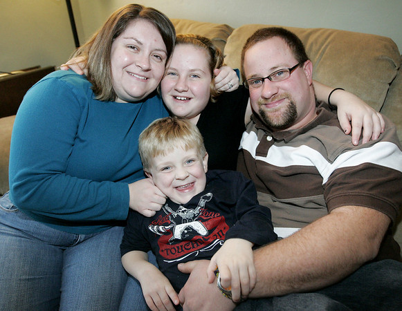Salem: The Clement Family from left, mom Amy, Alyssa, 12, Nathan, 4(???), and dad Rich. Former Salem High School students Amy and Rich, had their first child Alyssa, when they were sophomores. The school's Teen Parent Program helped Amy to be able to stay at school.<br /> Photo by Deborah Parker/Salem News Saturday, December 06, 2008
