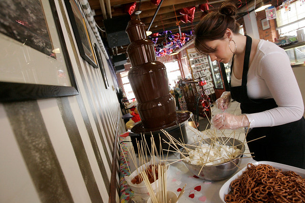 Salem: Rachael Cetalu of Peabody, an employee of Maria's Sweet Somethings, prepares items to be dipped in their chocolate fountain as part of Salem's annual chocolate and ice sculpture festival, called Salem's So Sweet. In addition to the various ice sculptures around town, stores are offering lots of chocolate menu items, free samples, and wine tastings. The event lasts through February 14th. Photo by Deborah Parker/Salem News Saturday, February 7 ,2009.