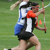 Beverly's Lainey Bernfield is defended by Danvers' Anna Dinitto during yesterday's game held at Danvers High School. Photo by Deborah Parker/April 27, 2010