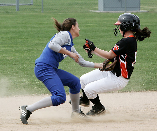 Danvers: Danvers' Alicia Dean tags Beverly's Courtney Chalifour before she could make it to second base during yesterday's game held in Danvers. Photo by Deborah Parker/Salem News May 01, 2009