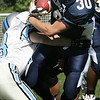 North Shore Tech's Jesse Wilkins is brought down by Bristol-Plymouth's Josh Levesque during Saturday's game held at Barry Field in Middleton. Photo by Deborah Parker/September 19, 2009