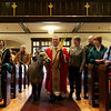 In celebration of Palm Sunday, Reverand Richard Burton surprised the children at children's mass by walking a miniature mule, Firefly, down the center aisle during the processional. Firefly's owner, Soso Whaley of New Hampshire walks with them. PHoto by Deborah Parker/March, 28, 2010