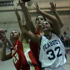 Peabody's Brittany Lefave and Everett's Rachel Pierce and Amanda DeSouza fight for control of the ball near the hoop during last night's Division 1 North first round girls basketball playoff game held at Peabody Veterans Memorial High School. Photo by Deborah Parker/February 22, 2010