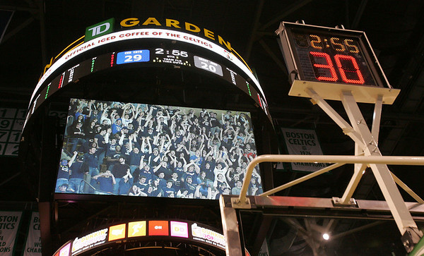 St. John student's are seen on the jumbotron cheering on their team as they played Central Catholic during last night's Division 1 Sectional Finals at the Garden Friday evening. Photo by Deborah Parker/March 5, 2010