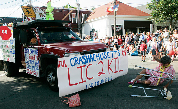 """Bill McPhail of Beverly falls to the ground after being """"hit"""" with a truck during the annual Beverly Farms Horribles parade. The float by the BFLA played parodies on the recent car accidents involving elderly drivers. Photo by Deborah Parker/July 4, 2009."""
