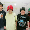 Bates School students, who typically aren't allowed to wear hats in school, had a Hats for Haiti Day at school on Tuesday. Kids and teachers could donate 50 cents to $2 to wear a hat to school with the proceeds benefiting UNICEF for Haiti relief. From left, fifth grade students Peter Corcoran, Devin Sobezenski, Tylar Conti and Alexandra Szczechowicz, show off their hats. Photo by Deborah Parker/February 9, 2010