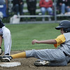Peabody West's Mike Petrosino is just seconds to late as Lynnfield's Nick Pascucci tags second base during yesterday's Little League sectionals held at Wyoma Field. Photo by Deborah Parker/July 23, 2009