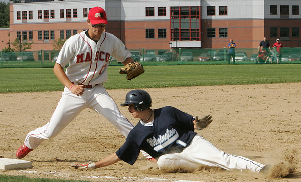 Masco's Ben Panunzio tags out Wilmington's Vinny Scito before he could reach third base Monday's Division 2 North quarterfinal's state tournament game against held in Topsfield. Photo by Deborah Parker/June 7, 2010