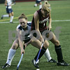 Wenham: Gordon College's Emily Peterson tries to gain control of the ball over Eastern University's Amanda Maloney during last night's Field Hockey Classic game held at Gordon. As of the first half, Gordon was down 0-3. Photo by Deborah Parker/Salem News Friday, August 29, 2008