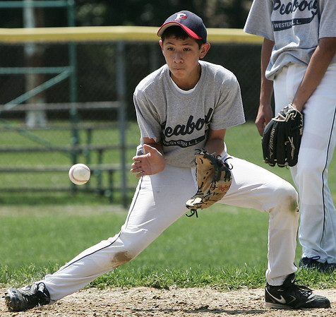 Peabody West's Mike Petrosino participates in a fielding drill at the teams practice at Cy Tenney field yesterday afternoon. Photo by Deborah Parker/July 28, 2009