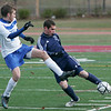 Lowell: Hamilton-Wenham's Shawn Tucker??? protects the ball against Bromfield's Connor Davy during Saturday's Division 3 State Championship held in Lowell. Hamilton-Wenham lost 4-2. Photo by Deborah Parker/Salem News Saturday November 22, 2008.