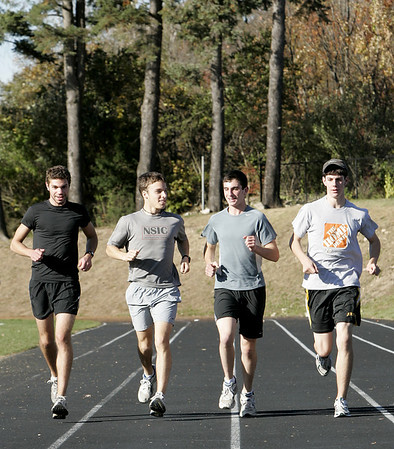 Danvers: St. John's Prep cross country senior teammates, from left, Julian Gallo, Mike Masse, Brian Keiran and Tim Murtagh run together during practice. <br /> Photo by Deborah Parker/Salem News Friday, October 24, 2008