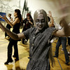 "Salem: Mayra Torres of Salem practices dancing to the zombie song ""Thriller.""  On Saturday people gathered at Salem State College and joined together with people all over the world in an attempt to break a Guinness record for having the most people dance the ""Thriller"" dance at one time.<br /> Photo by Deborah Parker/Salem News Saturday, October 25, 2008"