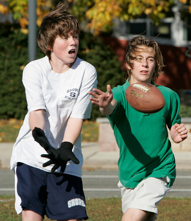 Beverly: A group of ninth grade students from Shore County Day School made good use of the crisp fall air Thursday afternoon to play game of tag football. From left, Donald Craig, of Wenham and Sky Williams, of Manchester. <br /> Photo by Deborah Parker/Salem News Thursday, October 30, 2008.