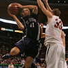 St. John's Mackenzie Burt is defended in front of the hoop by Central Catholic's Jimmy Zenevitch during last night's Division 1 Sectional Finals at the Garden Friday evening. Photo by Deborah Parker/March 5, 2010