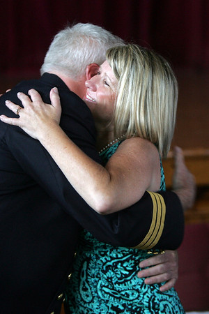 Josephy Daly is congratulated by his wife, Cathie, after being sworn in as the new fire department Deputy Chief during a ceremony held at Peabody City Hall Wednesday morning. Photo by Deborah Parker/July 7, 2010