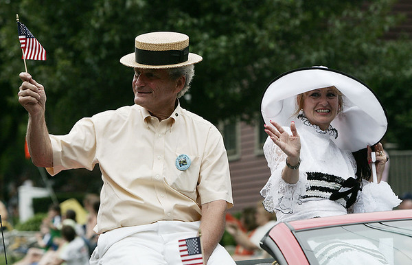 Nat Pulsifer and Joanne Lattanzi, chair and co-chair of Ipswich's 375th anniversary parade wave to the crowd during the parade Sunday afternoon. The celebration included the parade, speakers, picnic and concert. Photo by Deborah Parker/August 9, 2009