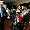 Boxford resident Christina Eckert is revealed after winning a makeover as part of the Boxford Elementary School Trust's fashion show fundraiser held at the Ipswich Country Club Wednesday evening. Eckert is shown with her husband ( dont have his name) photo by deborah parker/february 3, 2009