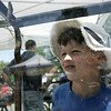 Henry Mulholland, 7, of Topsfield checks out a snake as it tried to climb its display case during the MassAudubon nature festival held at the Ipswich River Wildlife Sanctuary Sunday. Henry's family was at the festival display goats from the Valley View Farm. Photo by Deborah Parker/May 31, 2009