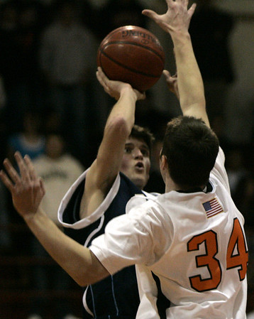 Beverly : Peabody's Ryan English looks to make a basket against Beverly's Chris Mooney during their game at Bevery Friday evening. Photo by Deborah Parker/Salem News Friday, December 12, 2008
