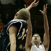 Beverly : Beverly's Justin Marrs looks to make the rebound against Peabody's Alex Marc-Aurele during their game at Bevery Friday evening. Photo by Deborah Parker/Salem News Friday, December 12, 2008