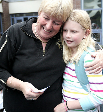 """Brenda Berry, a fifth grade teacher at Hannah Elementary School gives graduating fifth grader, Meredith Enright a big hug on the last day of school Wednesday afternoon. Speaking about Meredith and another student, Berry said, """"These are the best fifth graders in Beverly."""" Photo by Deborah Parker/June 24, 2009"""