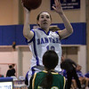 Danvers' Kellie Macdonald is defended in front of the net by Lynn Classical's Brianna Capone during last night's Division 2 North girls basketball firt round playoff game held at Danvers High School. Photo by Deborah Parker/February 24, 2010