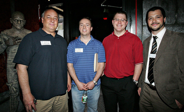 From left, Jim Armstrong and Mark Wade of Armstrong and Field Real Estate along with Jeff Magdis of MBA Mortgage and Ben Bouchard with the Salem Chamber of Commerce attend the Chamber After Hours event at Count Orlok's Nightmare Gallery on Thursday evening. Photo by Deborah parker/april 22, 2010