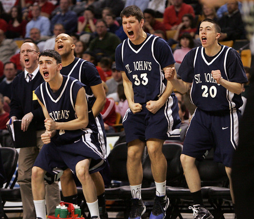 St. John's bench reacts after scoring during last night's Division 1 Sectional Finals at the Garden Friday evening. Photo by Deborah Parker/March 5, 2010