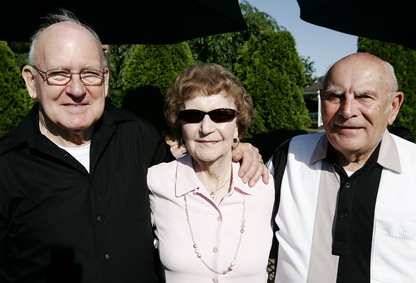From left, Norm Dobson and Irene and Gerry Boutin, all of Peabody pose together before surprising Bert Russell with a honorary diploma from Beverly High School, 50 years after he left school early to serve in the Korean War.