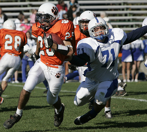Beverly : Beverly's Curtis Manuel avoids the tackle by Danvers' Nick Pellino during Saturday's game at Hurd Stadium. Photo by Deborah Parker/Salem News Saturday, October 18, 2008