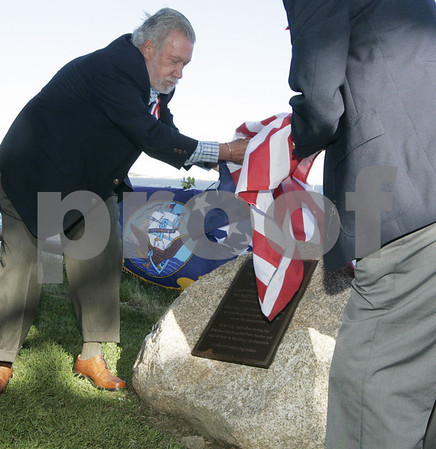 Marblehead: Tom McNulty of Marblehead unveils a new plaque at Fort Sewall during a ceremony dedicating the warship USS Constitution and it's history with Marblehead. Photo by Deborah Parker/Salem News Thursday, September 18, 2008