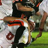 Melrose's Cody Lusas attempts to bring down Beverly's Dylan Terry during last night's game under the lights at Hurd Stadium. Photo by Deborah Parker/September 17, 2009