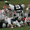 Danvers: St. John Prep's George Sessons makes a diving leap over Masconomet's defensive line during Saturday's game held at St. John's. As of the third period St. John's was leading 22-7.<br /> Photo by Deborah Parker/Salem News Saturday, September 06, 2008