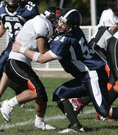 North Shore Tech's Steven Simpson defends Greater Lawrence Tech's Joseph Pizzuot during the Saturday afternoon game held at North Shore Tech in Middleton. Photo by deborah parker/october 9, 2010