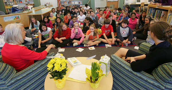 "Cheryl Opolski, left and Courtney Davis, both from the Salem Public Library, talk to fifth graders at Witchcraft Heights Elementary school about the book, ""The Lemonade War"" by Jacqueline Davies that group had just finished reading. Photo by Deborah Parker/April 15, 2010"