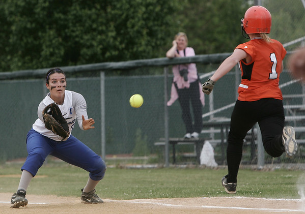 Danvers' Alicia Dean catches the ball before Woburn's  Molly Finlyason could reach the plate during yesterday's Division 1 North Semi Final game held at Martin Park in Lowell. Photo by Deborah Parker/June 4, 2009