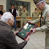 Ipswich resident and World War II veteran, James Medeiros, accepts several ribbons and medals that he earned during his tour of duty but never received as part of a ceremony in his honor at the VFW Post in Ipswich Friday evening. Major William Duke presents the medals to Medeiros. Photo by Deborah Parker/December 4, 2009