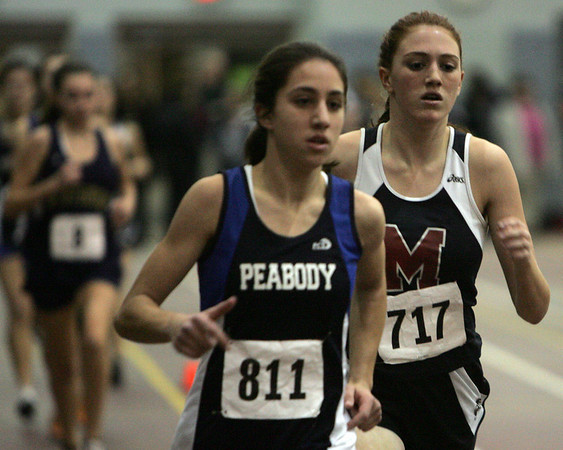 Peabody's Catarina Rocha and Marblehead's Mary Kauffman compete in the one mile during last night's meet against Marblehead and Lynn English held at Marblehead High School. Photo by Deborah Parker/January 11, 2009