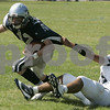 Hamilton: Hamilton Wenham's Jay Bial is tackled by Lynnfield's Gino Cohee during yesterday's game held at Hamilton-Wenham. Photo by Deborah Parker/Salem News Saturday, September 13, 2008