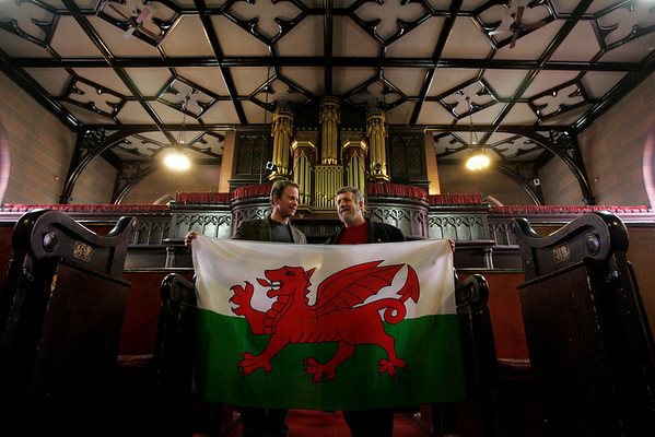 Salem: Reverand Jeffrey Barz-Snell, left, and Reverand Phil Wyman stand in the sanctuary of the First Church in Salem with a Welsh Flag. The church will be holding a big Wales Celebration on Saturday. Photo by Deborah Parker/Salem News Thursday, February 26, 2009.