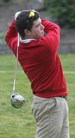 St. John's Nick Maccario tees off at the first hole during yesterday's match against Masconomet held at Kernwood Country Club. Photo by Deborah Parker/October 21, 2009
