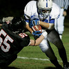 Marblehead: Danvers' T.J. Stanley is brought down by Marblehead's Colby Bates during last night's game at Marblehead. Photo by Deborah Parker/Salem News Thursday, October 24, 2008.