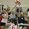 Topsfield: Peabody's Mackenzie Carpenterattempts to block a spike by Masco's Amanda Guidi during yesterday's match held at Masconomet Regional High School. <br /> Photo by Deborah Parker/Salem News Friday, September 26, 2008