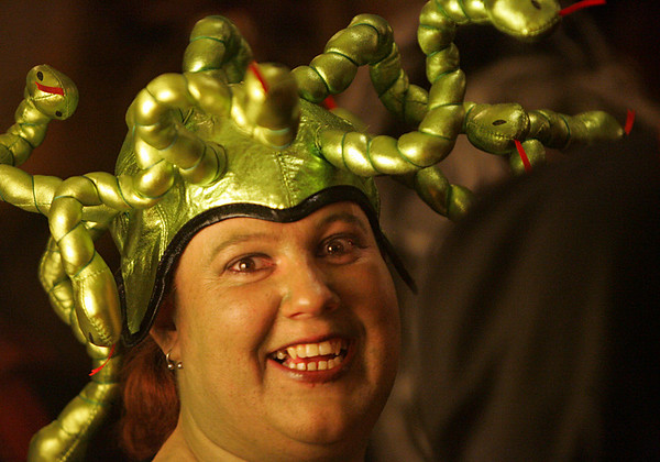 Donna Eleby, of New Jersey and on her honeymoon, strikes a pose while waiting in line to enter the Witches' Ball held at the Hawthorne Hotel Friday evening. Photo by Deborah Parker/October 30, 2009