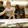 Collins Middle School eighth grade students, from left Kamila Buchanan, Kelsey Stiefel and Chabelys Abreu work to build a banner for a fundraiser dance at the school tomorrow called Hearts for Haiti. Each heart represents someone who died in the earthquake in Haiti last month. Photo by Deborah Parker/February 8, 2010