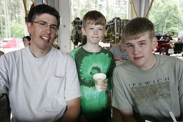 From left, Gary Blaney of Wenham poses with his sons, George, 19, and Giles, 15 while attending the first ever chicken barbeque, a fundraiser for the Hamilton Fire Department. Photo by Deborah Parker/June 20, 2009