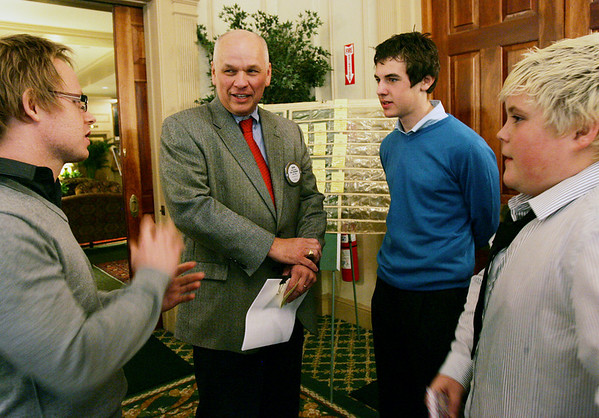 Rotarian David Gendall who is also on the board of directors for the Friends Forever program talks with chaperone Ricky Garnett, left, along with students, Matthew Drayner and Karl Beare. Photo by Deborah Parker/October 27, 2009